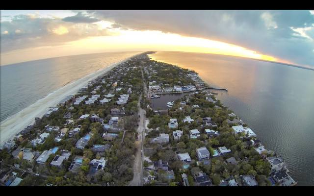 This is our little town of Fire Island Pines with the harbor in the center, the Atlantic on the left and the Great South Bay on the right. No streets, no cars, only birds, the ocean and the occasional beat of a distant bass line to break the silence.