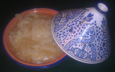 Steamy, succulent Baked Onions looking tasty in a Tunisian Tajine Mary B. gave us for Christmas a few years back.