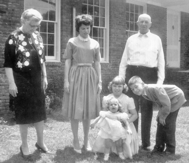 Grandmama and Granddaddy come for a visit, Easter Sunday 1963. That's Mama in the middle, of course, with Miriam, new sister Mary Baker, and me.